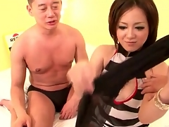 Young Japanese lass gives a blowjob