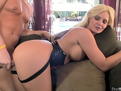 Blonde gives her man a stroking while he rides on her strap-on