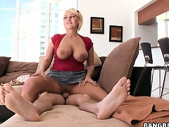 Bootylicious blond MILF with huge titties mounts a stiff wiener